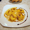 Dinner at La Grotta - Ricotta raviolis with a most sauce (pressed grapes)