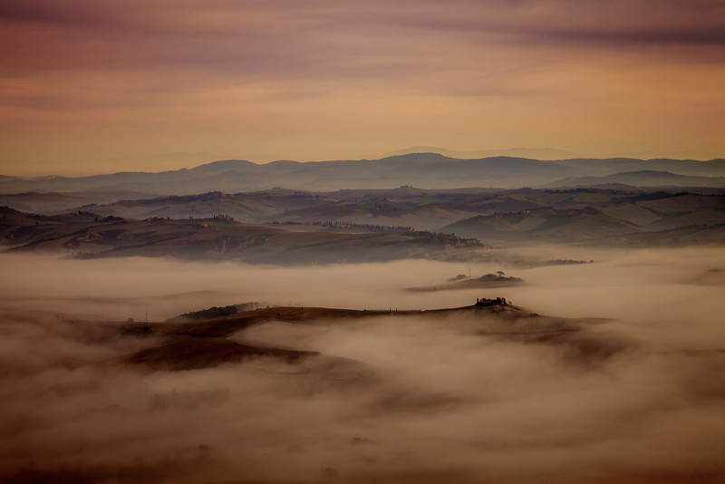 Foggy sunrise in the Val d'Orcia from Montalcino