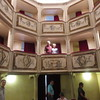 We are standing in box seat location in Monte Castello di Vibio the Teatro della Concordia. The world's smallest theater.