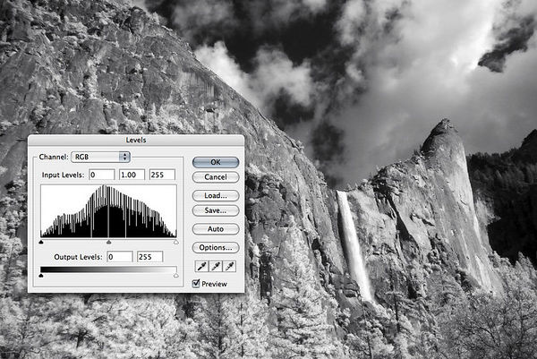 Give Photoshop's Auto Levels a try, you will be pleased with the results!