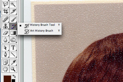 Select the history brush from your Tool Palette.