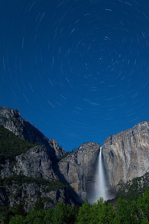 "By <a href=""http://coscorrosa.smugmug.com"">Ron Coscorrosa</a>.  <i>Left: Upper Yosemite Falls and Polaris. The falls were front lit by a full moon.</i>  Many landscape photographers concentrate their efforts during sunrise and sunset, the two so-called golden or magic hours, but there is a third magic ""hour"" that is often neglected: night!  With digital photography it's now easier than ever to take high quality night photographs, and this is especially true of star shots, including star trails and (the relatively less common) still star shots, such as those of the Milky Way.  While digital has made most aspects of night photography easier, it does present its own unique challenges, mostly in the form of noise.  This tutorial will address that issue, explain how to take star shots in the field, and how to post process them when you get home. Keep in mind that many of the techniques described are applicable to night photography in general and not exclusive to star photography."