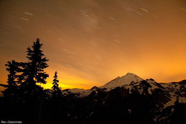 "<i>Right: 6 minutes, f/5.0, ISO 400 at 28mm. If you can't beat light pollution, join it. This is a shot of Mt. Baker facing west to the town of Bellingham.</i>  Many photographers pack up their gear after sunset, but with digital, taking night photographs has never been easier, it's now possible to get the exposure, focus, and composition correct even when you can't see what you're photographing!  Noise is still a concern, but as digital camera sensors improve, it will become less and less of an issue. Huge improvements have been made in the last few years and I'm optimistic that in the future it will actually cease to be an issue altogether.  After a few outings at night you'll soon realize that sunset through sunrise is one large photo opportunity. Unlike during the middle of the day, night time light, even with a full moon, is much more diffused and soft, and unlike sunset or sunrise, night time light is a lot more predictable.  If the conditions are right, you can end up with stellar shots.  Yeah, I went there.    Discuss this on <a href=""http://www.dgrin.com/showthread.php?t=173664"">Digital Grin Forums</a>."