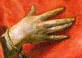 Here is a detail from Christ's hand. See how El Greco has outlined the fingers with dark lines? See how this makes them stand out against Christ's robe in the full painting? This is an example of sharpening. Pretty good for a guy who couldn't afford Photoshop.  Sharpening enhances the perceived sharpness of images by emphasizing the transitions between light and dark areas with <i>halos.</i> Just as El Greco drew a black halo around Christ's hand, sharpening draws halos at the points of transition. Actually, it draws two kinds of halos, a light and a dark halo. It both outlines dark areas with light halos and light areas with dark halos.