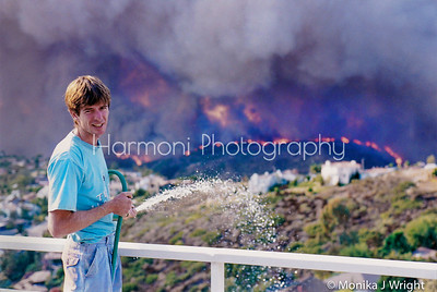 The day Laguna burned. So sad. So many lost their homes.  Mine was spared.  The emotions that were experienced at the time I took this photo were unlike any I have ever experienced.  The fire was raging closer and the planes were flying overhead.  The water pressure was next to nothing.  All the while my husband stayed so calm.  October '93