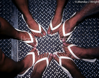A photo I took in High school, a long time ago. About 200  of us were on a train to Mexico and my closest friends, we all had the same thongs. When I saw the textured floor, I got my mates together for a couple shots. This one won me a scholarship towards Uni.