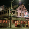 This Greenport restaurant is illuminated by several light sources and you can see how it affects the colors. Notice the couple having a late evening dinner. This image would look good on a variety of mediums but metallic could be magical.