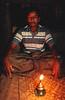 """San Hla, chef du village de l'île d'East Phayonka (communauté des """"Twin Zar"""") devant sa lampe à pétrole. Etat de l'Arakan/Birmanie (Myanmar)"""