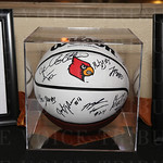 Silent auction items included this autographed U of L basketball.