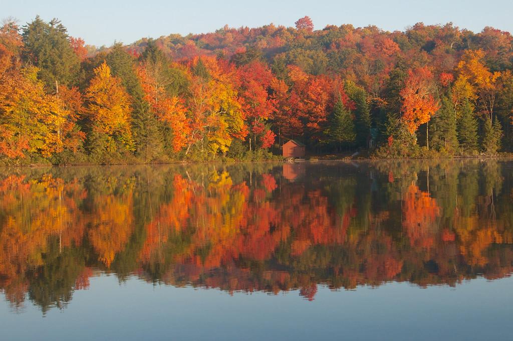 Boathouse nestled among the beautiful autumn colors