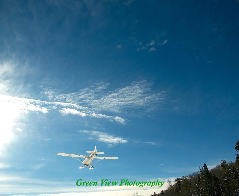 Sea Plane whizzes over the lake