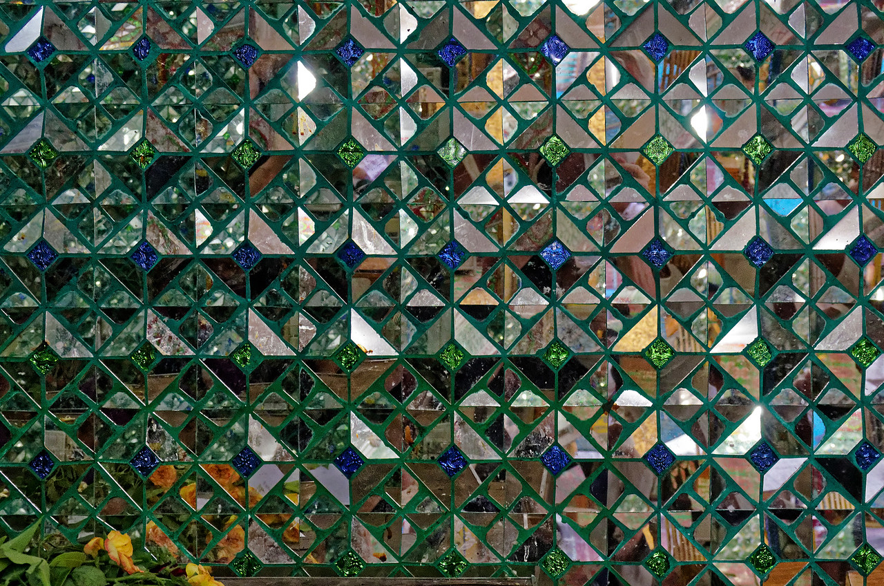 Detail from a decorative mirrored-tile wall at Botahtaung temple