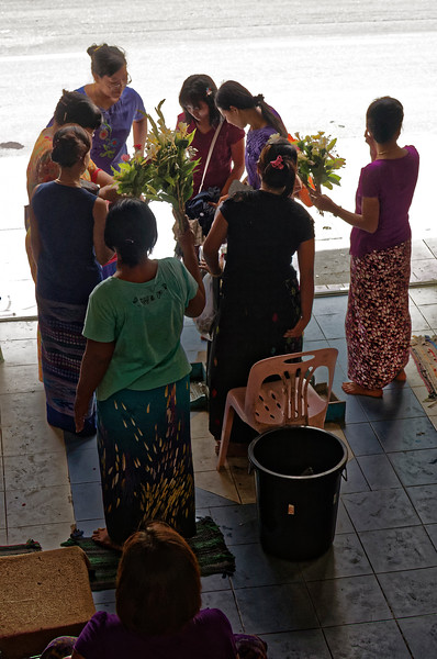 Buying flowers to present as offerings at temple