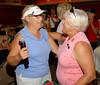 Pat Hutton congratulates outgoing MWGA President Carol Amling on a job well done!