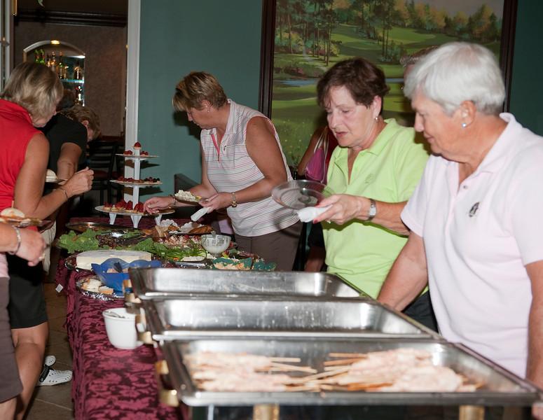 Pat Fuqua and partner Marcella Rose enjoyed the buffet.