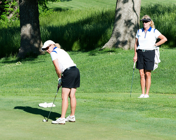 Diane Chancellor watches as partner Kathy Glennon tries to drain that putt.