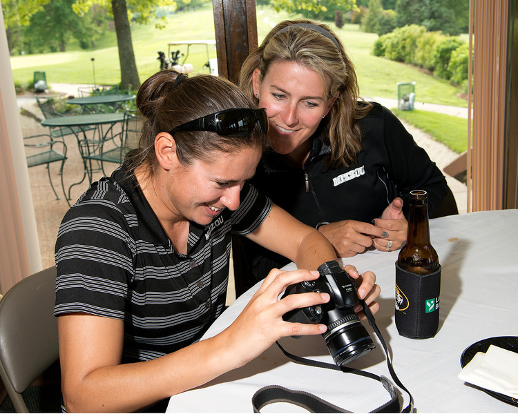 Mindy and Stephanie look at photos taken during the day