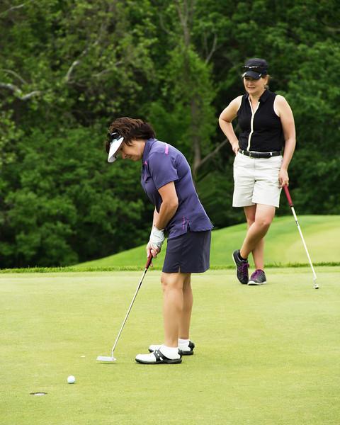 Karen pulls this putt just a little.....