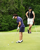 Karen pulls this putt just a little.....
