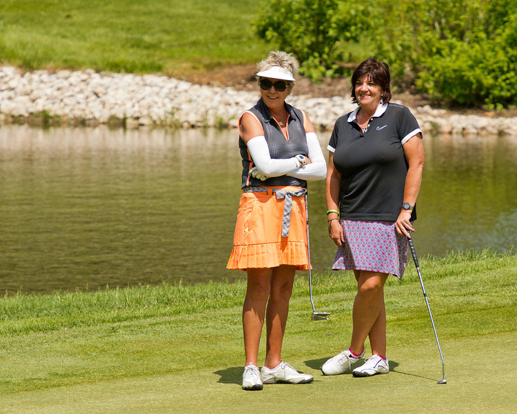 Cissy and Stephanie wait for their group to finish the hole...