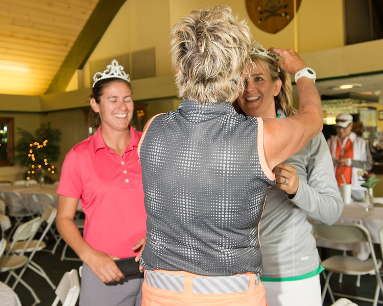 The tiaras are placed on the new Two Lady Scramble Champions!