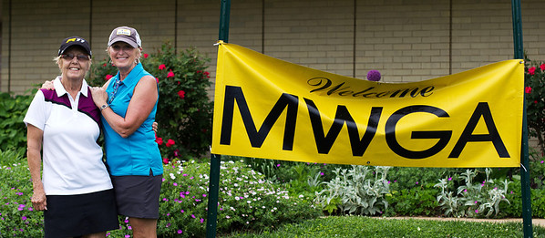 A great shot of Lynda Alcorn and Marcia Azan with the MWGA welcome sign