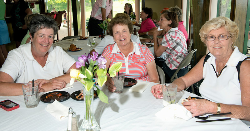 Enjoying a cocktail and appetizers really hits the spot for Linda Dellsperger, Mary Jane Turner and friend.