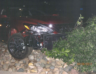 Courtesy photo Mt. Pleasant Police Dept.-  Police say a drunk 24-year-old Mt. Pleasant man hit an apartment building then drove down the road to another apartment complex where he got his car stuck on landscaping rocks.
