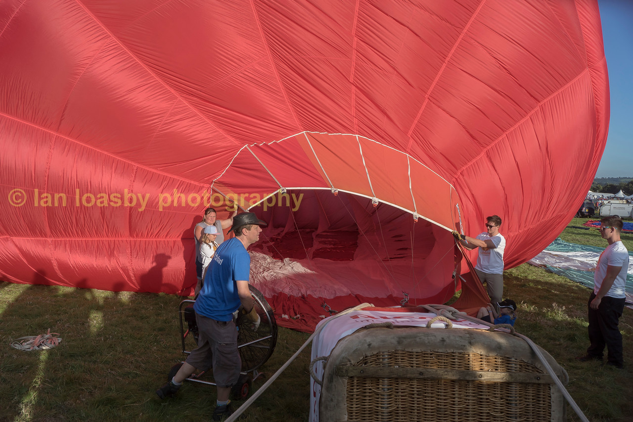 The basket is attached and the burners are secure, a high powerd fan blows ambient air into the balloon to initially inflate it , the next step is to light the burner to get hot air into the interior
