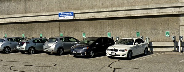 These cars are plugged into electric battery chargers.