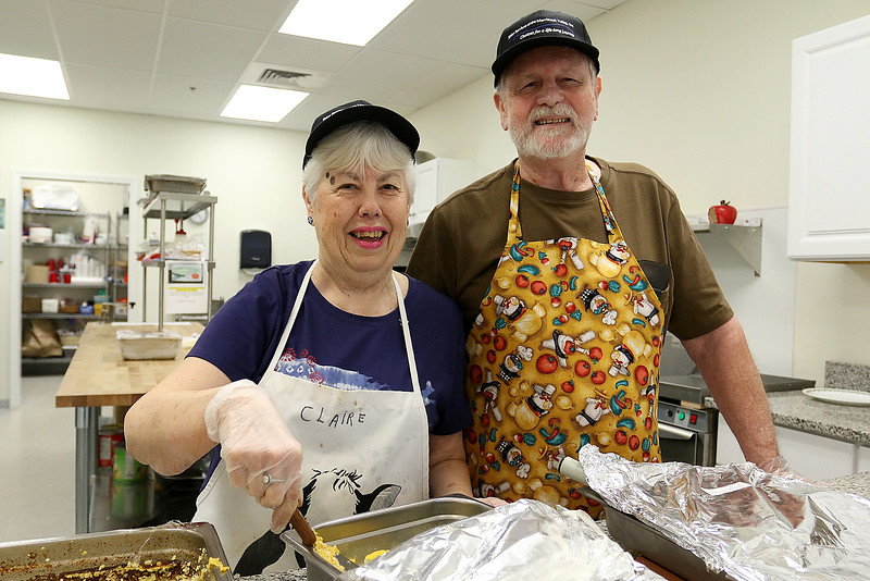 Claire, 80, and Roger Downing, 81, get the hot meals prepared for the meals on wheels as they volunteers at the Tyngsboro Council on Aging Monday, June 26, 2017. SUN/JOHN LOVE