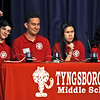 Tyngsboro Middle School Knowledge Bowl Team members L-R, Joshua Gauvin 13, puts his arm up after his name is called, Brett Cavanaugh 15, Evianna Young 12, and Barthina Boules. SUN/David H. Brow