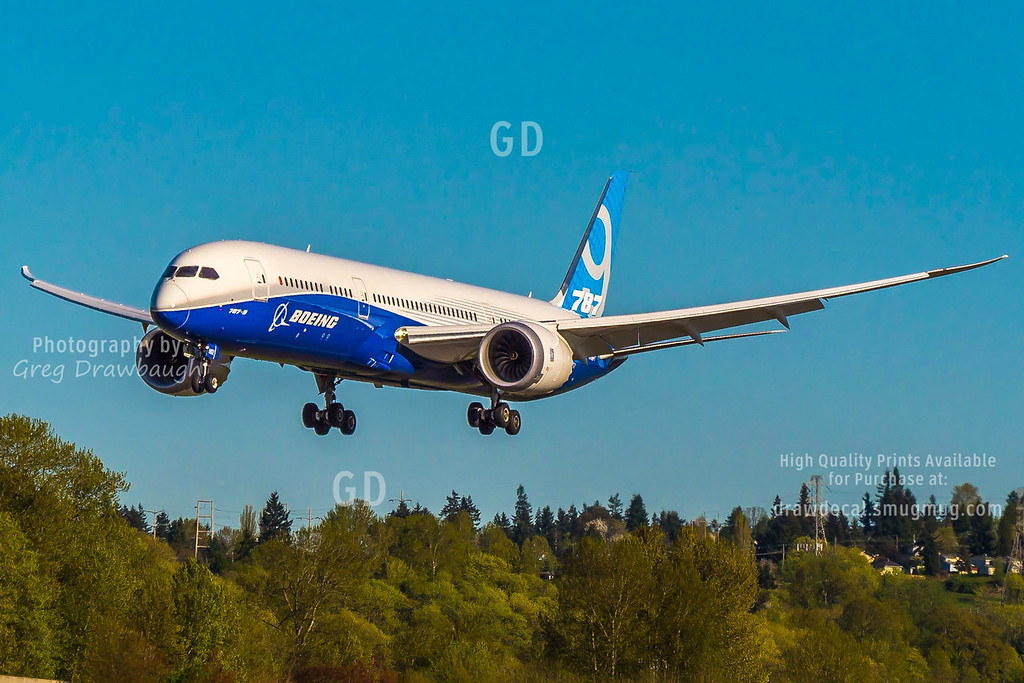 The first Boeing 787-9 Dreamliner N789EX  returns from a test flight on this gorgeous Sunday afternoon and is seen here landing at Boeing Field