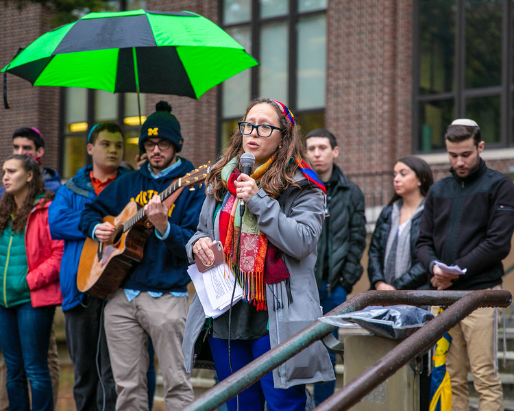 Rav Lisa Stella leads the vigil in song at the University of Michigan on October 28, 2018.
