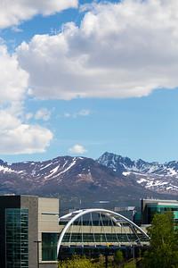 EIB Health building bridge in front of the Chugach mountain range. Summer on the campus of the University of Alaska Anchorage  20170601-Campus-life-TEK-011.JPG