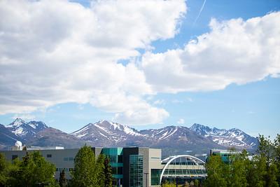 EIB Health building bridge in front of the Chugach mountain range. Summer on the campus of the University of Alaska Anchorage  20170601-Campus-life-TEK-013.JPG