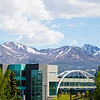"EIB Health building bridge in front of the Chugach mountain range. Summer on the campus of the University of Alaska Anchorage  <div class=""ss-paypal-button"">20170601-Campus-life-TEK-012.JPG</div><div class=""ss-paypal-button-end""></div>"