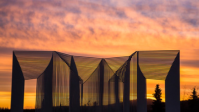 The Elysian sculpture is silhouetted from the stunning sunset display as seen from the Fairbanks campus. UAF photo by JR Ancheta.