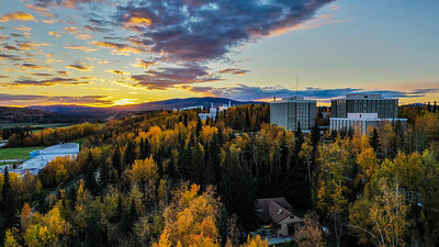 An aerial view of the Troth Yedha' campus as the sun sets behind the hills during an autumn evening. UAF photo by Todd Paris.