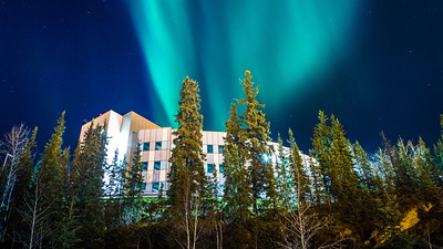 The aurora borealis shimmers across the night sky above the Duckering Building Extension on campus. UAF photo by JR Ancheta.