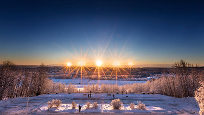 The sun rises and sets above the Alaska Range south of Fairbanks in this composite image as seen from the roof of the Reichardt Building where the UAF Natural Science & Mathematics is housed on Dec. 21, the day of the winter solstice. UAF photo by JR Ancheta.