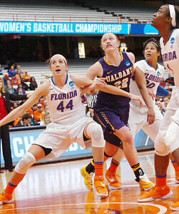 STAN HUDY - SHUDY@DIGITALFIRSTMEDIA.COM UAlbany's Heather Forster (22) looks to block out Florida's Haley Lorenzen (44) and Simone Westbrook (20) Friday afternoon at the Syracuse Carrier Dome as UAlbany defeated Florida, 61-59 in the NCAA women's opening round, 61-59.