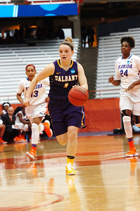 STAN HUDY - SHUDY@DIGITALFIRSTMEDIA.COM UAlbany senior Erin Coughlin brings the ball up the courst in the second half Friday afternoon at the Syracuse Carrier Dome as UAlbany defeated Florida, 61-59 in the NCAA women's opening round, 61-59.