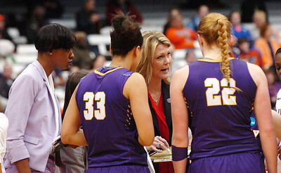 STAN HUDY - SHUDY@DIGITALFIRSTMEDIA.COM UAlbany coach Katie Abrahamson-Henderson talks to freshman Heather Forster (22) along with Tiana-Jo Carter (33) during a timeout with 18 seconds left Friday afternoon at the Syracuse Carrier Dome as UAlbany defeated Florida, 61-59 in the NCAA women's opening round, 61-59.