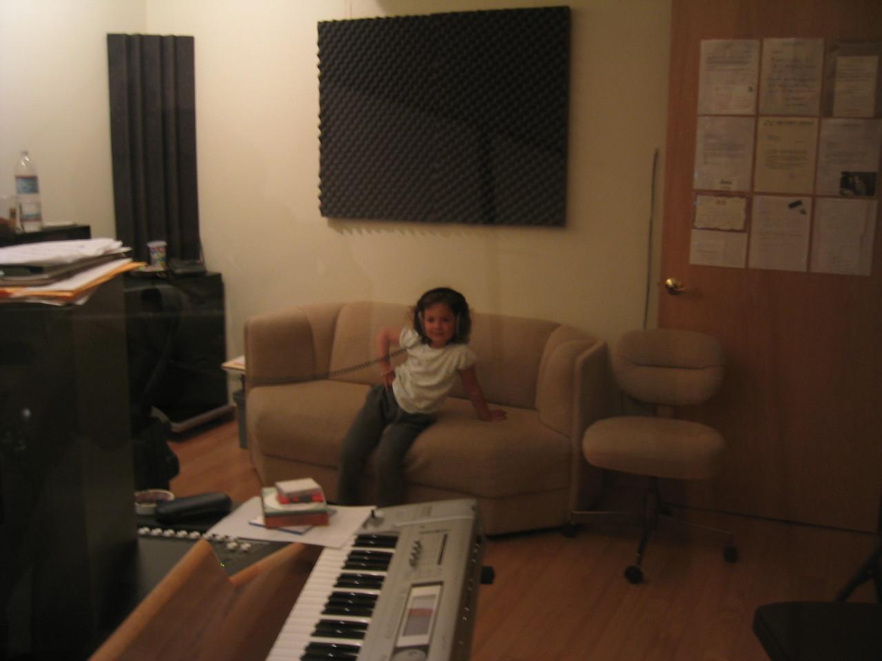 Cloe poses with headphones