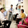 8:00 am: The huddle discussion turns to patients and the day's appointments.