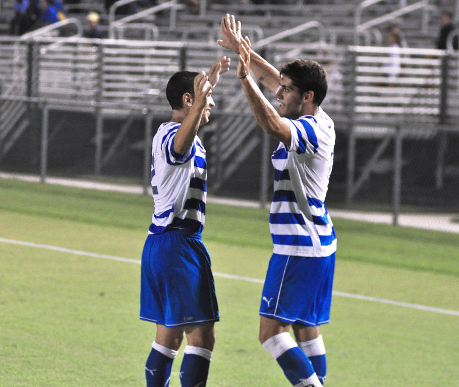 Gimenez and Ellis celebrate after a goal scored by Gimenez