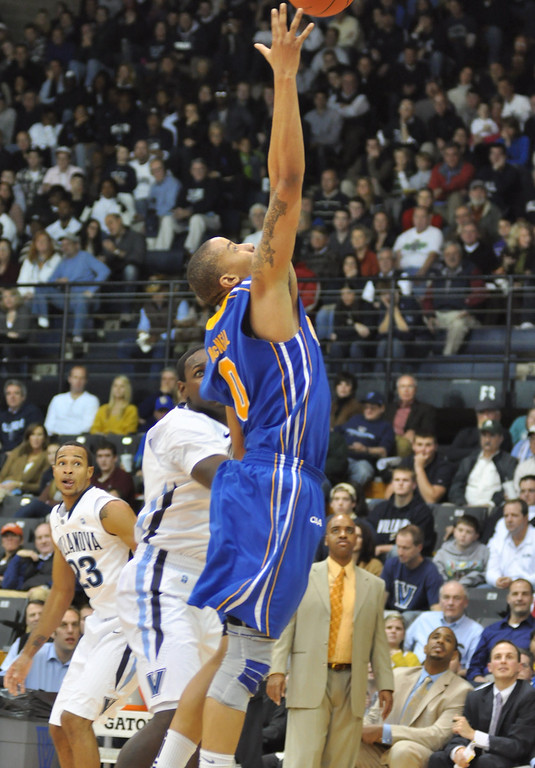 Kelvin McNeil goes up for the rebound