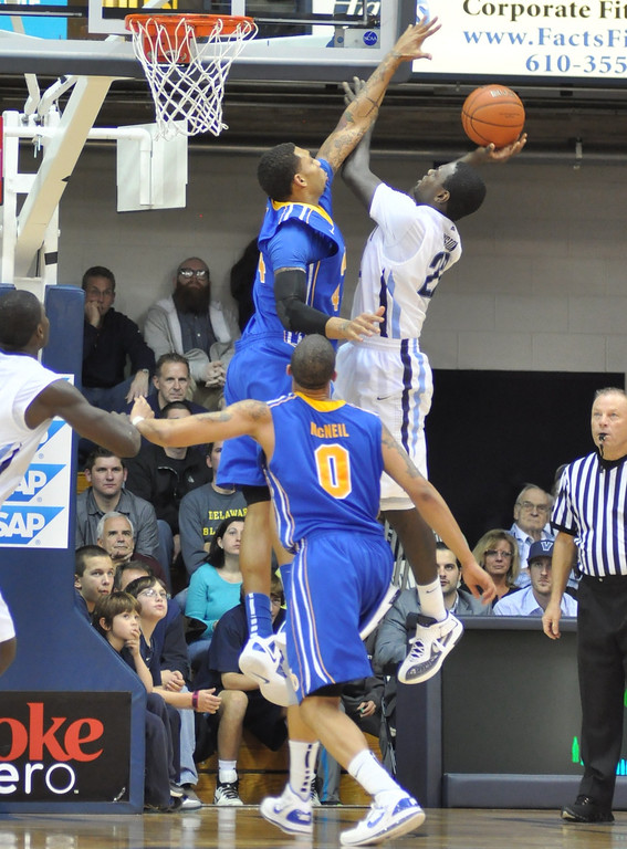 Jamelle Hagins leaps high to try to block a shot along the baseline
