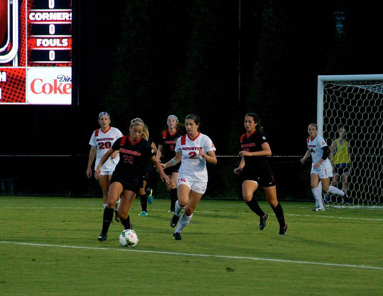 Alexa Antetomaso (26) in control of the ball, teammates Caroline Waters (8) and Natalie Goodman (18)